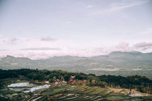 Indonesian Landscape Covered In Rice Paddies And Temple Photo