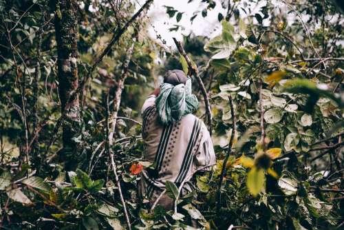 Man Wearing Loose Clothing Walks Through Jungle Photo