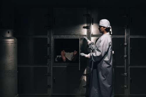 Morgue Attendant Closing A Freezer Photo