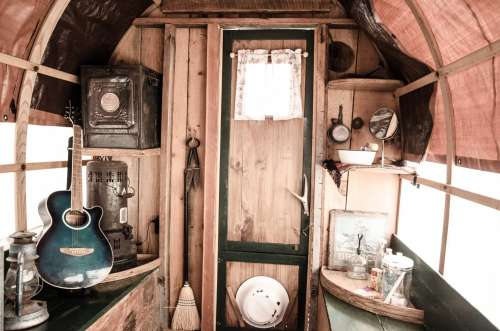 Musical and Rustic Domestic Objects Inside A Caravan Photo