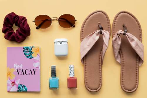 Packing Sunglasses And Cosmetics For A Holiday Photo