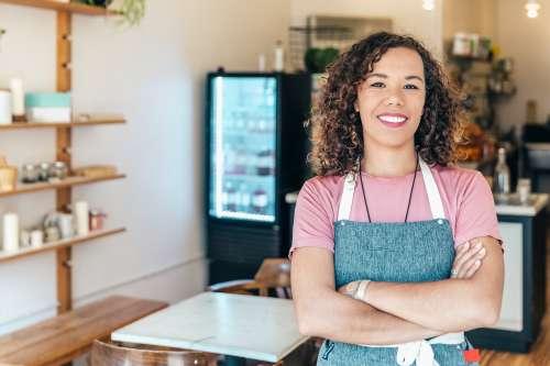 Smiling Cafe Owner Photo