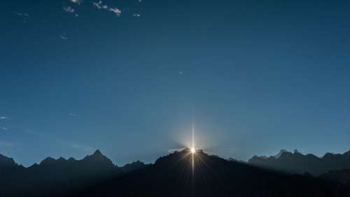 Sun Over Mountain Tops Photo