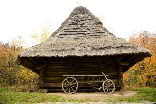 Thatched Hut And Wooden Cart Photo