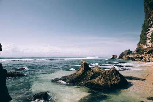 White Sand Beach Scattered With Large Boulders Photo