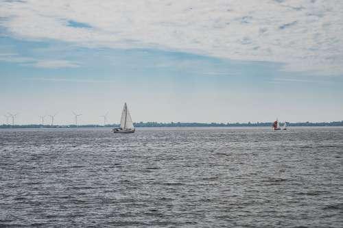 Wind Turbines And Yachts Photo