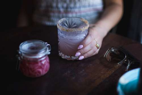 Woman Holds Cocktail Glass Photo