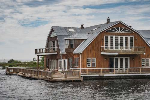 Wooden House At Waters Edge Photo