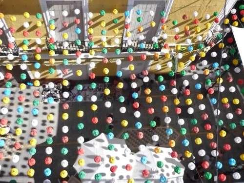 string lights lanterns colorful umbrellas outdoor cafe