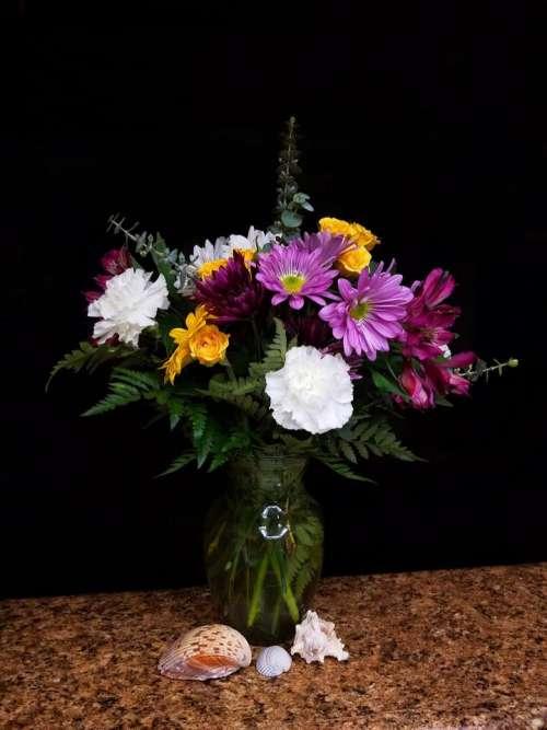 flowers bouquet vase arrangement seashells