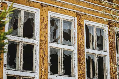 Broken Windows in an Old Abandoned Building Free Photo