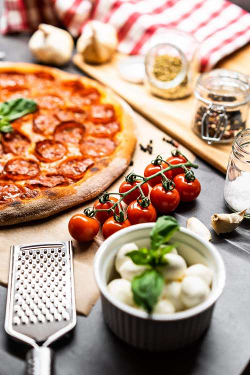 Cherry Tomatoes and Pizza Salami Free Photo