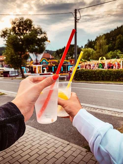 Girls Holding Drinks on Fun Fair Free Photo