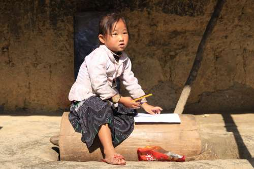 Hmong Little Girl Writing Doing Homework Village