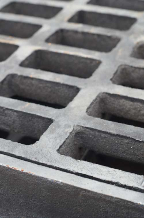 water grate iron abstract cover