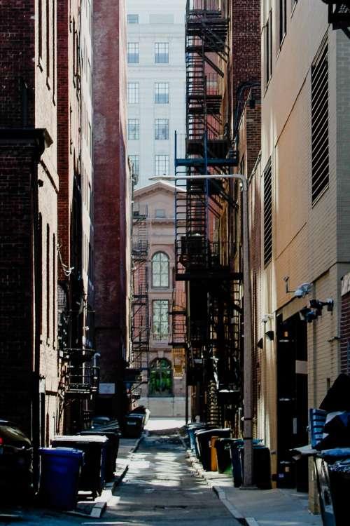 city fire escape buildings alley
