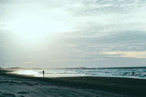 Jogger On A Sandy Beach Photo