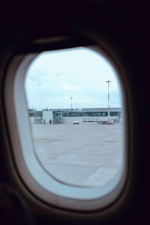 Airport Through Plane Window Photo