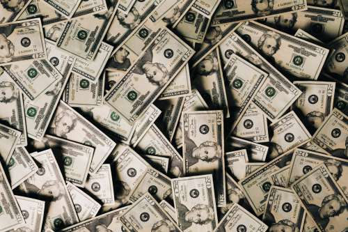 A Scattered Bundle Of Money Photo