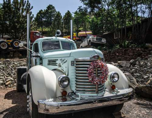Antique Trucks And Cars On Display Photo