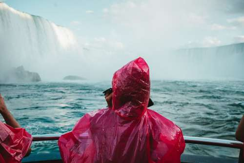 Red Poncho Blue Waterfall Photo