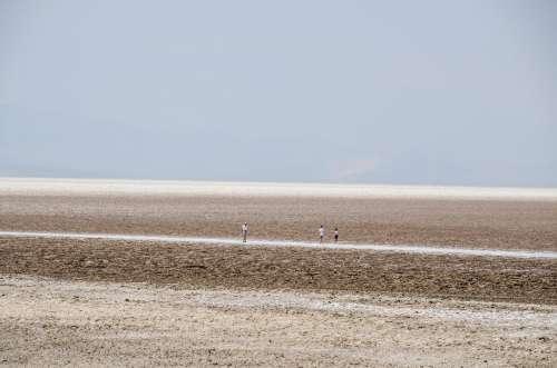 Tourists Traverse A Desolate Wasteland Photo