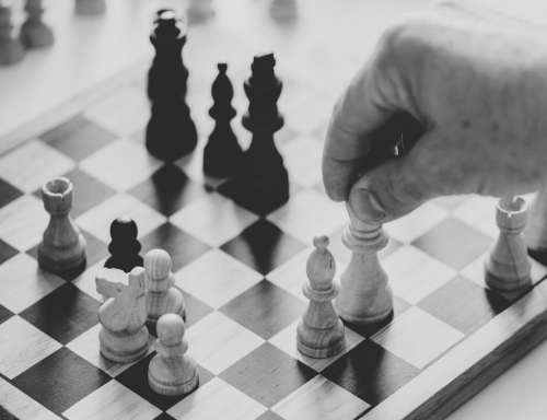 Close up of a person playing chess