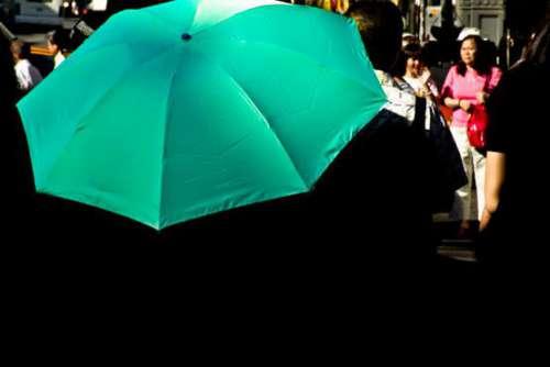 Woman With Green Umbrella Free Photo