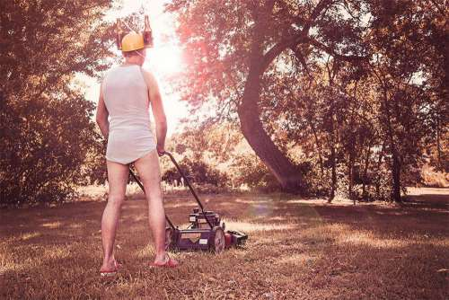 Man Mowing Grass Free Photo