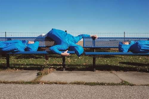 Blue Man on Bench Free Photo