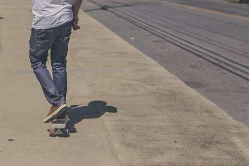 Man on Longboard Free Photo