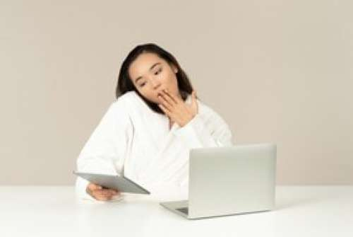 Gasping Young Asian Woman Talking On The Phone, Using Tablet And Doing Online Shopping