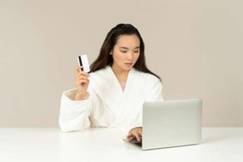 Bothered Young Asian Woman Doing Online Shopping