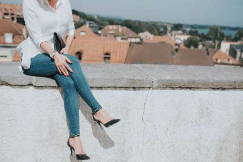 Fashion Woman Sitting Down