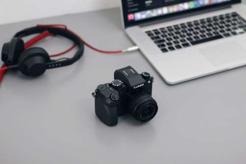 DSLR Camera, MacBook and Headphones