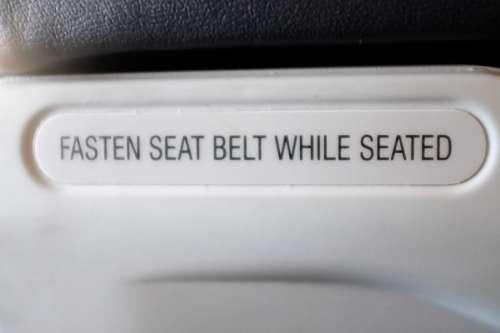 Fasten Seat Belt Sign on Plane