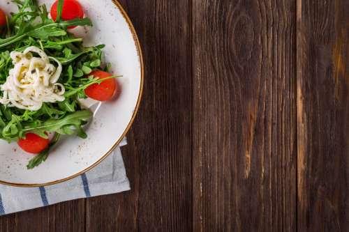 Salad on Wood Table Background