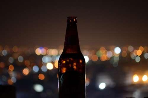 Beer Bottle in City