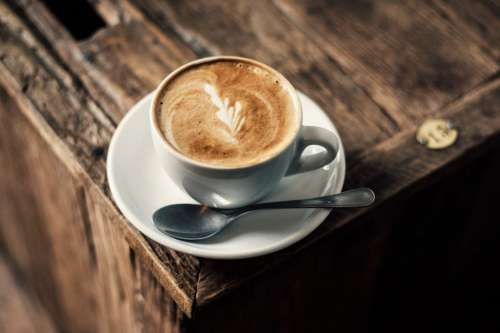 Cappuccino Coffee on Rustic Wooden Table