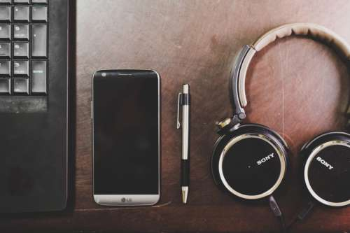 Laptop, Pen, Mobile and Music Headphones