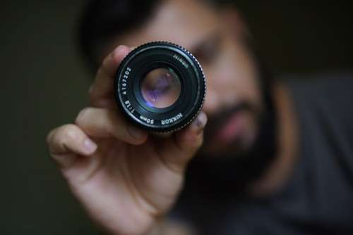 Photographer Holding Lens