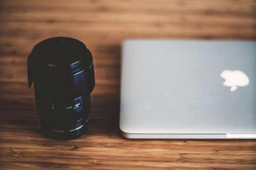 Canera Lens & MacBook Laptop on Wooden Desk