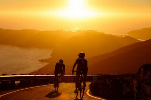 Men Cycling at Sunset