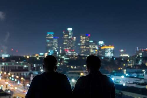 Men Viewing City