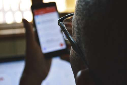 Man Using Phone Online