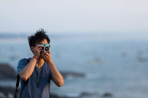 Photographer Using Camera