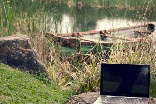 Laptop Computer Near Lake