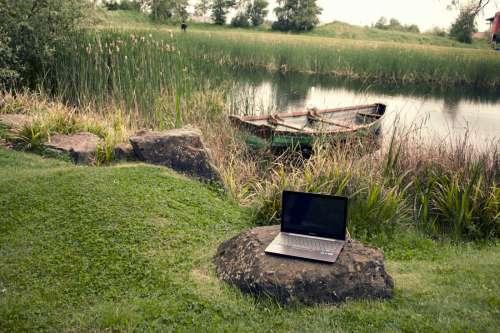 Laptop on Lake