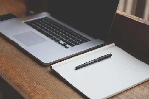 Laptop, Notepad & Pen on Desk