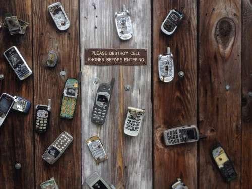 Mobile Phone & Broken Wood
